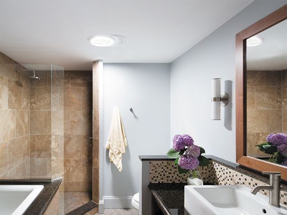 Solar tubes, Glass, and Mirrors Brighten Small Dark Bathrooms